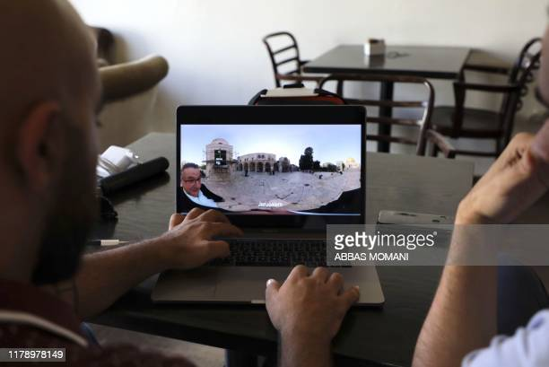 "Salem Barameh, executive director of the Palestine Institute for Public Diplomacy, watches a video on the computer for the ""Palestine VR"", a new..."