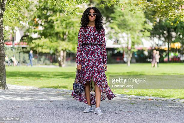 Salem Indrias wearing a red dress with floral print from Tommy Hilfiger and white sneaker and sunglasses outside Schwedish Fashion Talents during the...