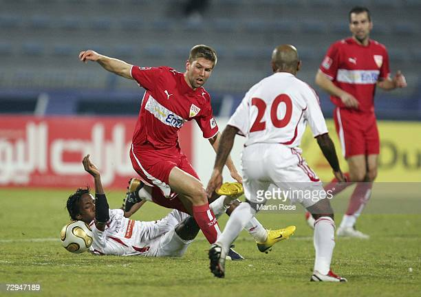 Salem Khamis of United Arab Emirates tries to stop Thomas Hitzlsperger of Stuttgart during the Dubai Challenge Cup match between Vfb Stuttgart and...