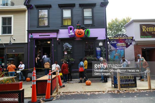 """October 16, 2020: Shoppers line up to enter the """"nCrow Haven Corner in Salem, Massachusetts."""
