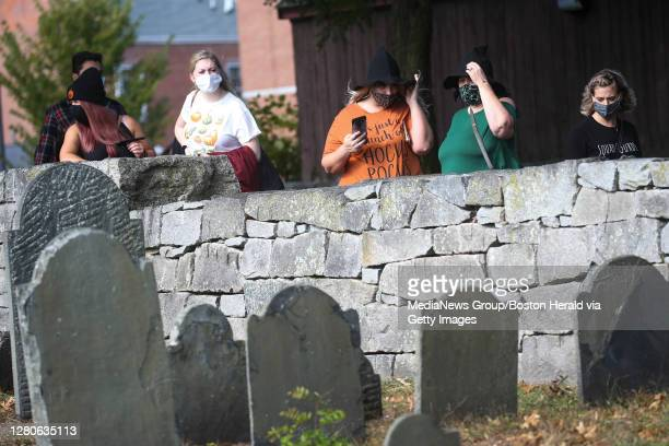 October 16, 2020: Visitors stop to view the Charter Street Cemetery in Salem, Massachusetts.