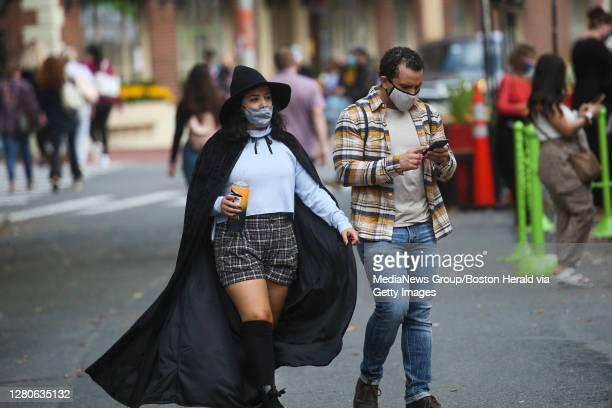 October 16, 2020: Visitors wear masks as they walk along the Essex Street Pedestrian Mall in Salem, Massachusetts.