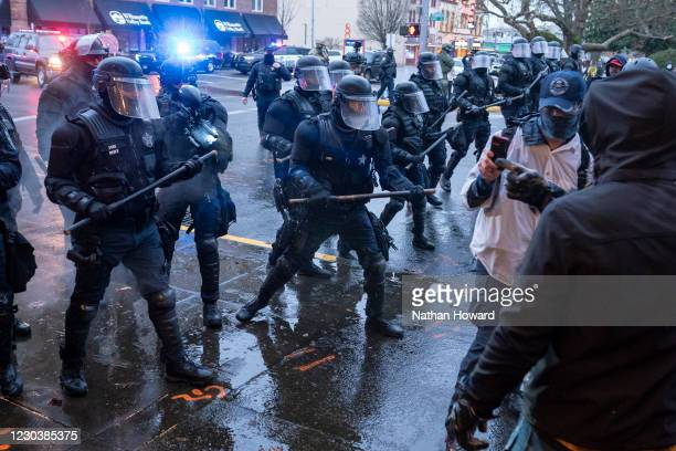 Salem Police disperse members of the far-right during a protest against COVID-19 restrictions on January 1, 2021 in Salem, Oregon. Police declared...