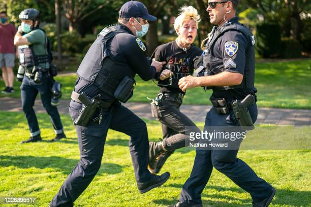 Salem police escort a counter protester away from the scene after a clash with a far-right protester on September 7, 2020 in Portland, Oregon. A...