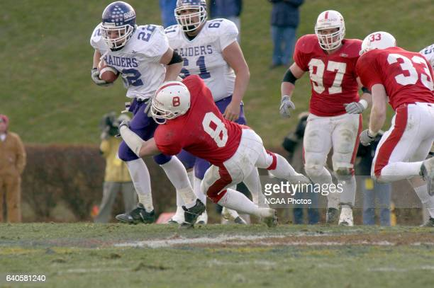 Salem Virginia 12/20/03 St John's LB Jamie Steffensmeier tackles Mt Union's Jeff Strauch during the NCAA Photos via Getty Images Men's Division 3...