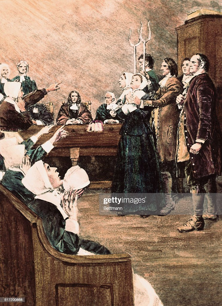 Salem Witch Trial. Accusation of bedeviled girl. After an engraving by Howard Pyle.