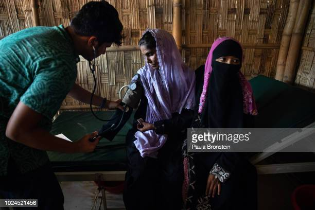 Salema Hatu gets treated accompanied by her daughter Setera in the Médecins Sans Frontières/Doctors Without Borders clinic on August 27 2018 in...