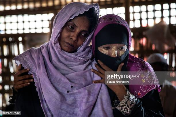 Salema Hatu is held by her daughter Setera in the Médecins Sans Frontières/Doctors Without Borders clinic on August 27 2018 in Balukhali camp Cox's...