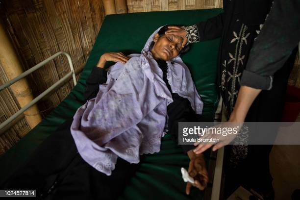 Salema Hatu is touched by her daughter Setera while being treated in the Médecins Sans Frontières/Doctors Without Borders clinic on August 27 2018 in...