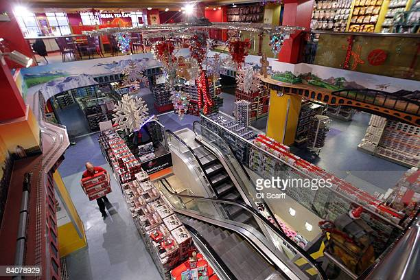 A sales assistant in the Hamleys toy store on Regent Street arranges the stock of toys prior to opening on December 18 2008 in London England Staff...