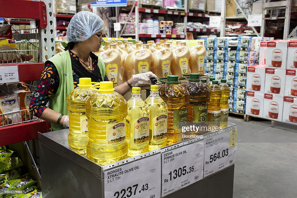 A sales assistant promotes cooking oils at a Walmart India