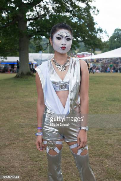 Sales Assistant Yasmin Young wears an Aldo necklace Cyberdog jumpsuit and bra top make up by Its in your dreams on day 3 of Wilderness Festival on...