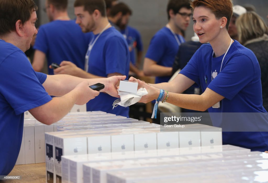 Sales assistants prepare new Apple iPhone 6 phones and other Apple products at the Apple Store on the first day of sales of the new phone in Germany on September 19, 2014 in Berlin, Germany. Hundreds of people had waited in a line that went around the block through the night in order to be among the first people to buy the new smartphone, which comes in two versions: the Apple iPhone 6 and the somewhat larger Apple iPhone 6 Plus.
