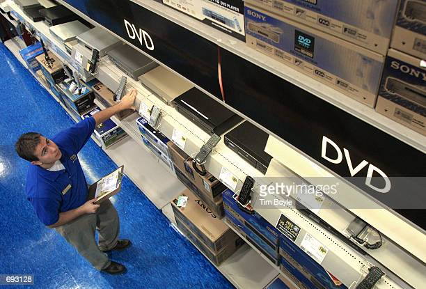 Sales associate Brian Kucha checks DVD players in stock at a Best Buy store January 11 2002 in Niles IL The Minnesotabased consumer electronics...