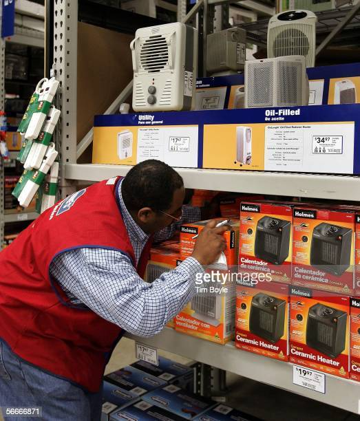 Sales associate Curtis Carter checks space heater inventory in a Lowe's home improvement store January 25 2006 in Lincolnwood Illinois As energy...