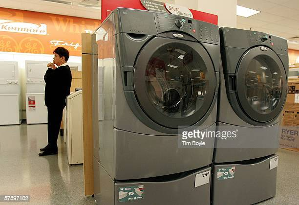 Sales associate Fran Krull stands near a Whirlpool Duet washer and dryer at a Sears store May 12 2006 in Niles Illinois Whirlpool reportedly may be...