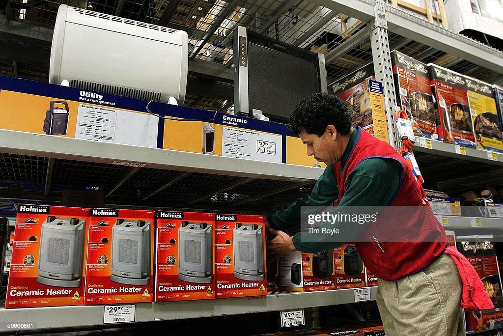 Sales Associate Jorge Rosales Stocks Space Heaters In A Loweu0027s Home  Improvement Store January 25,