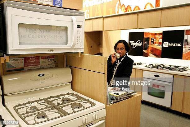 Sales associate Shaista Ansari talks on the phone to a customer near a a Whirlpool microwave and a Maytag range at a Sears store May 12 2006 in Niles...