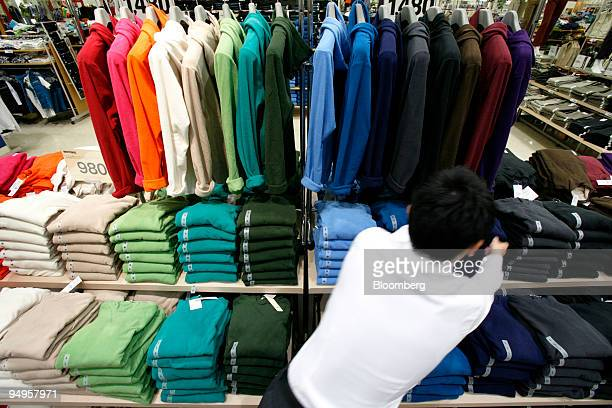 A sales clerk displays clothes at Aeon Co's Jusco store in the Aeon Tsudanuma shopping center in Narashino City Chiba Prefecture Japan on Friday Sept...