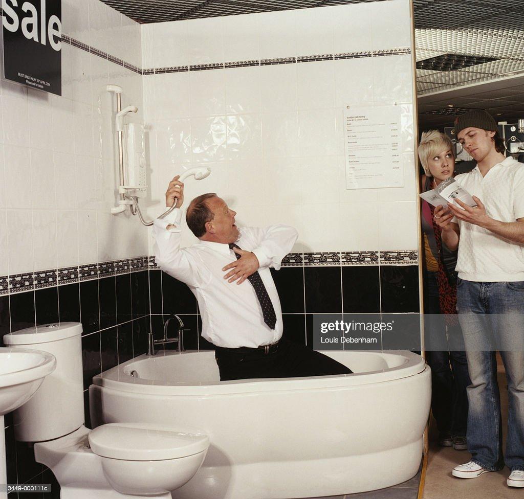 Sales Clerk Selling Bathtub Stock Photo | Getty Images