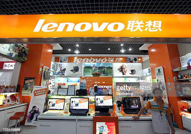A sales clerk stands in a Lenovo Group Ltd store inside a computer market in in Beijing China on Thursday Aug 19 2010 Lenovo Group Ltd China's...