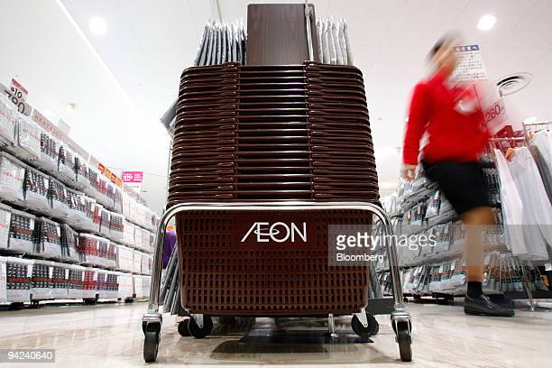 A sales clerk walks near shopping baskets stacked at Aeon Co's Jusco store in the Aeon Lake Town shopping mall in Koshigaya City Saitama Prefecture...