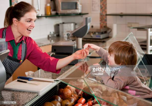 Sales executive giving sausage to toddler