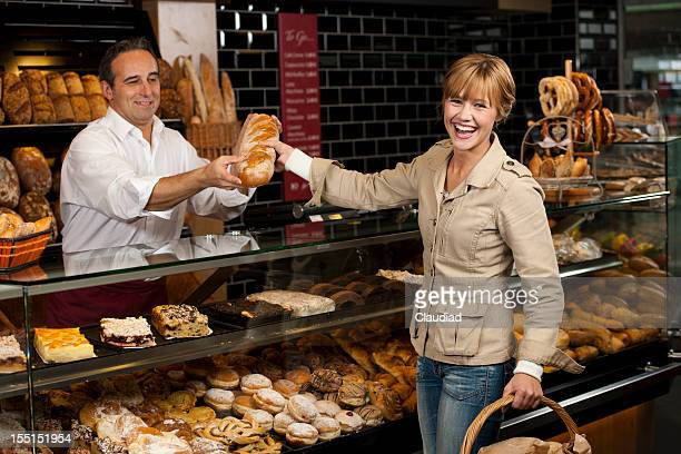 Sales executives selling bread in bakery