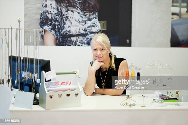 sales lady standing behind her counter in a shop