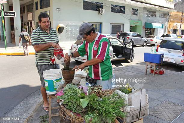 sales man is selling Terere an infusion of yerba mate