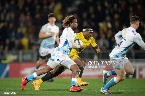 Sales' Marland Yard runs with the ball during the European Rugby Champions Cup match between La Rochelle and Sale Sharks at the Marcel Deflandre...