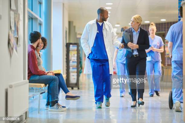 sales person at the hospital - medical building stock pictures, royalty-free photos & images