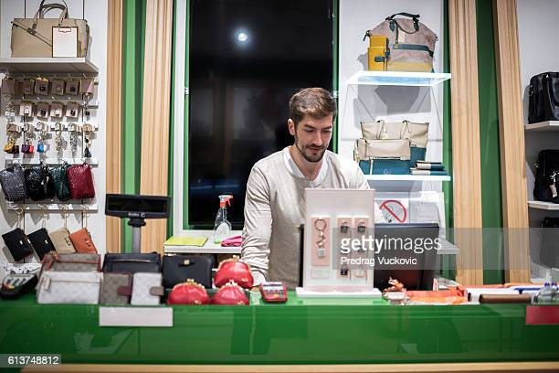 Sales person inside accessory store