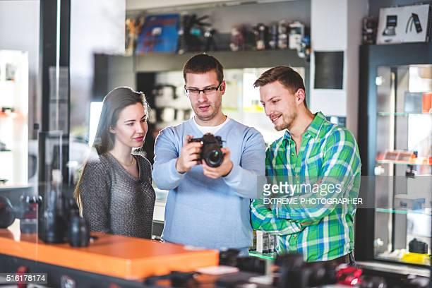 Sales person showing digital camera