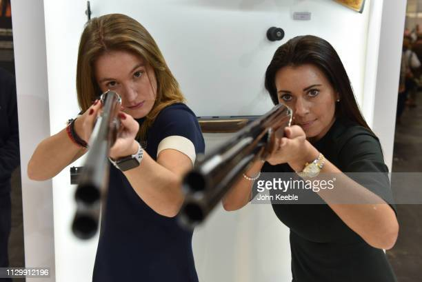 Sales persons Imogen Green and Tanya Faulds hold Tempo Syren Sporting and Tempo Syren Light shotguns at NEC Arena on February 15 2019 in Birmingham...