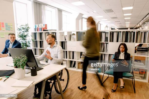 sales professionals working in office - differing abilities fotografías e imágenes de stock