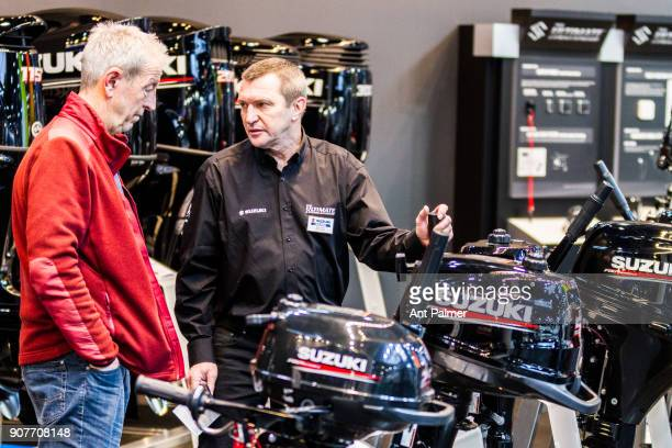 A sales representative from Japanese manufacturer Suzuki displays the companies outboard engines at boot Dusseldorf 2018 on January 20 2018 in...