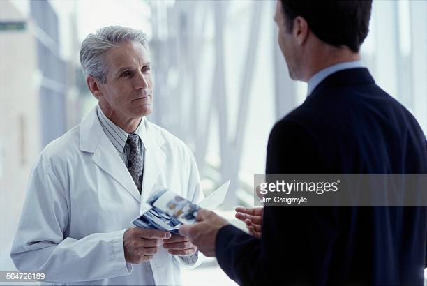 Sales Representative Meeting with Doctor