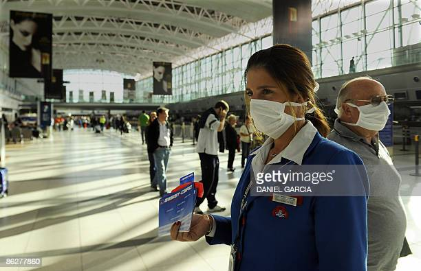 A sales representative offerd her product wearing a facemask at Ezeiza international airport in Buenos Aires on April 29 2009 The Argentine National...