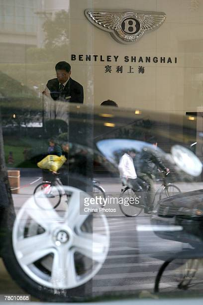 Sales staff work in a Bentley flagship store on November 19 2007 in Shanghai China The United Kingdom based company has posted record results for the...
