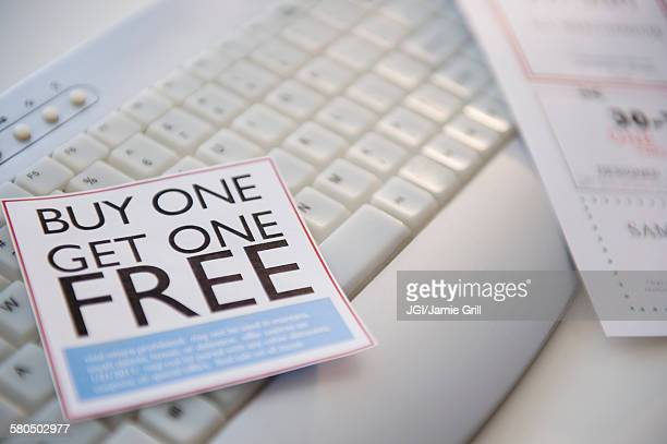 sales sticker on computer keyboard - coupon stock photos and pictures