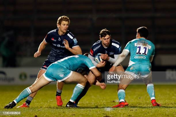 Sales Tom Roebuck is tackled by Worchester players during the Gallagher Premiership match between Sale Sharks and Worcester Warriors at AJ Bell...