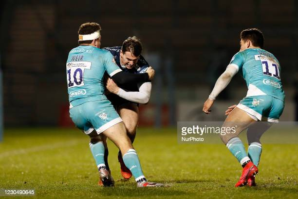 `Sales Tom Roebuck is tackled by Worchesters Duncan Weir during the Gallagher Premiership match between Sale Sharks and Worcester Warriors at AJ Bell...