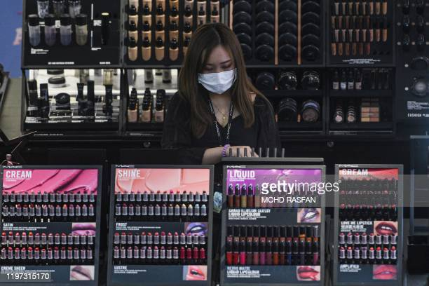 A sales woman wears a face mask at a beauty product shop at Kuala Lumpur International Airport 2 in Sepang on January 29 2020 Malaysia banned...
