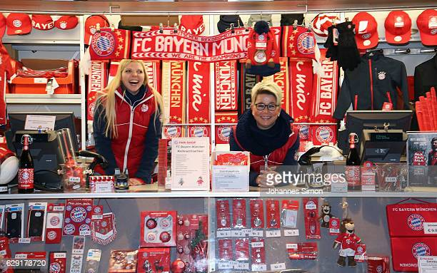Sales women of a FC Bayern fan shop laugh during the FC Bayern Muenchen Christmas Market at Allianz Arens on December 11 2016 in Munich Germany
