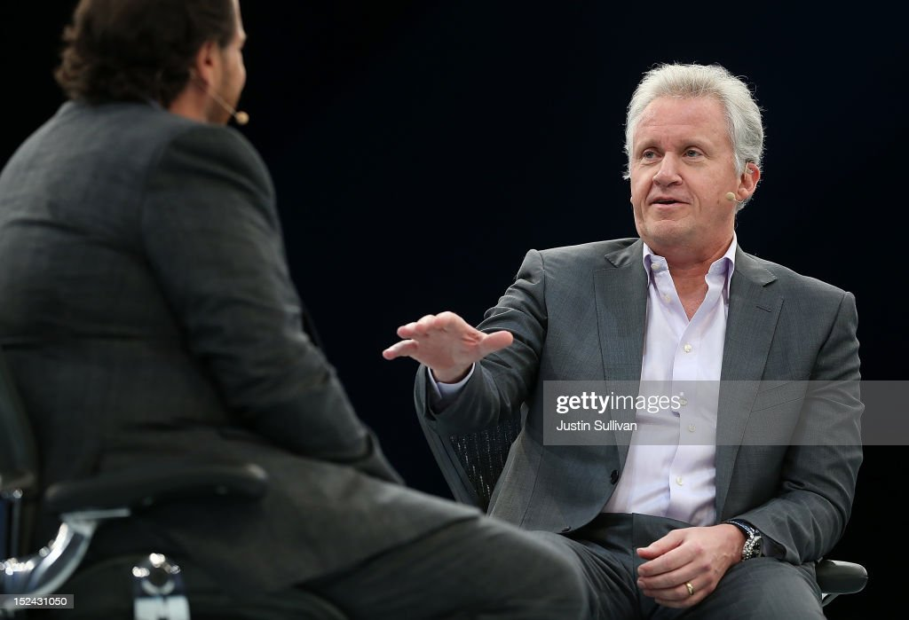 Salesforce CEO Marc Benioff (L) looks on as General Electric CEO Jeff Immelt (R) speaks during the Dreamforce 2012 conference at the Moscone Center on September 20, 2012 in San Francisco, California. A reported 90,000 people registered to attend the cloud computing industry conference Dreamforce 2012 that runs through September 21.