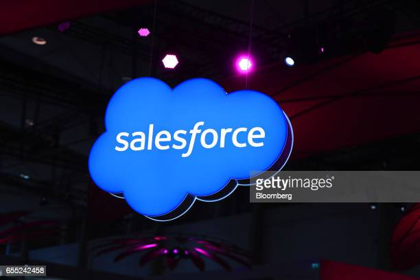 A SalesforceCom Inc logo sits on an illuminated icloud lightbox hanging from the ceiling at the CeBIT 2017 tech fair in Hannover Germany on Sunday...
