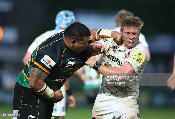 Salesi Ma'afu of Northampton hits Leicester hooker Tom Youngs which resulted in Ma'afu being sent off by referee JP Doyle during the Aviva...