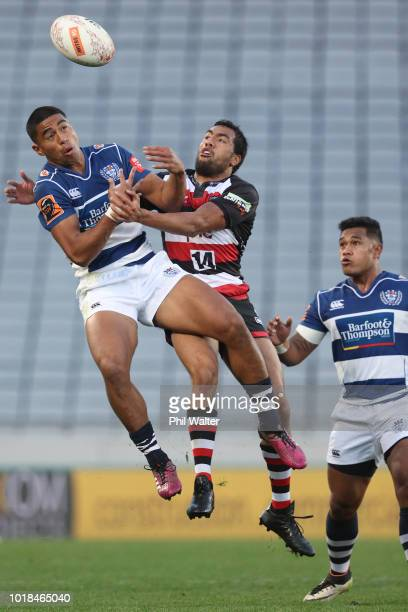 Salesi Rayasi of Auckland and Sione Molia of Counties contest the high ball during the round one Mitre 10 Cup match between Auckland and Counties...