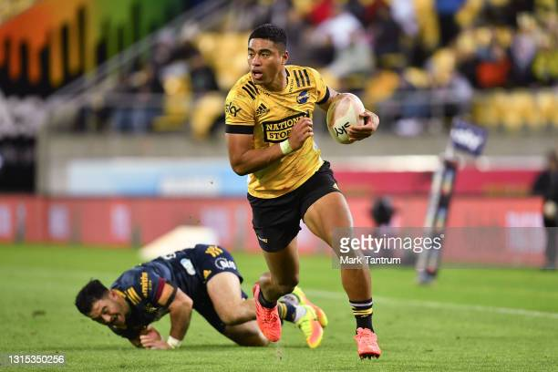 Salesi Rayasi of the Hurricanes beats a tackle to score during the round 10 Super Rugby Aotearoa match between the Hurricanes and the Highlanders at...